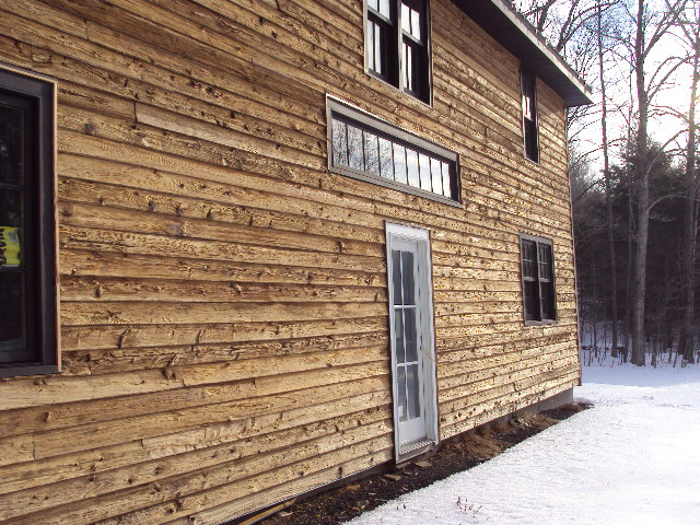 Another photo of the house with natural wood siding